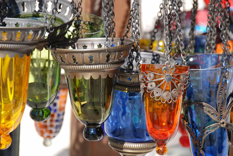 Colorful tea lamps hanging outside a shop in antalya photo